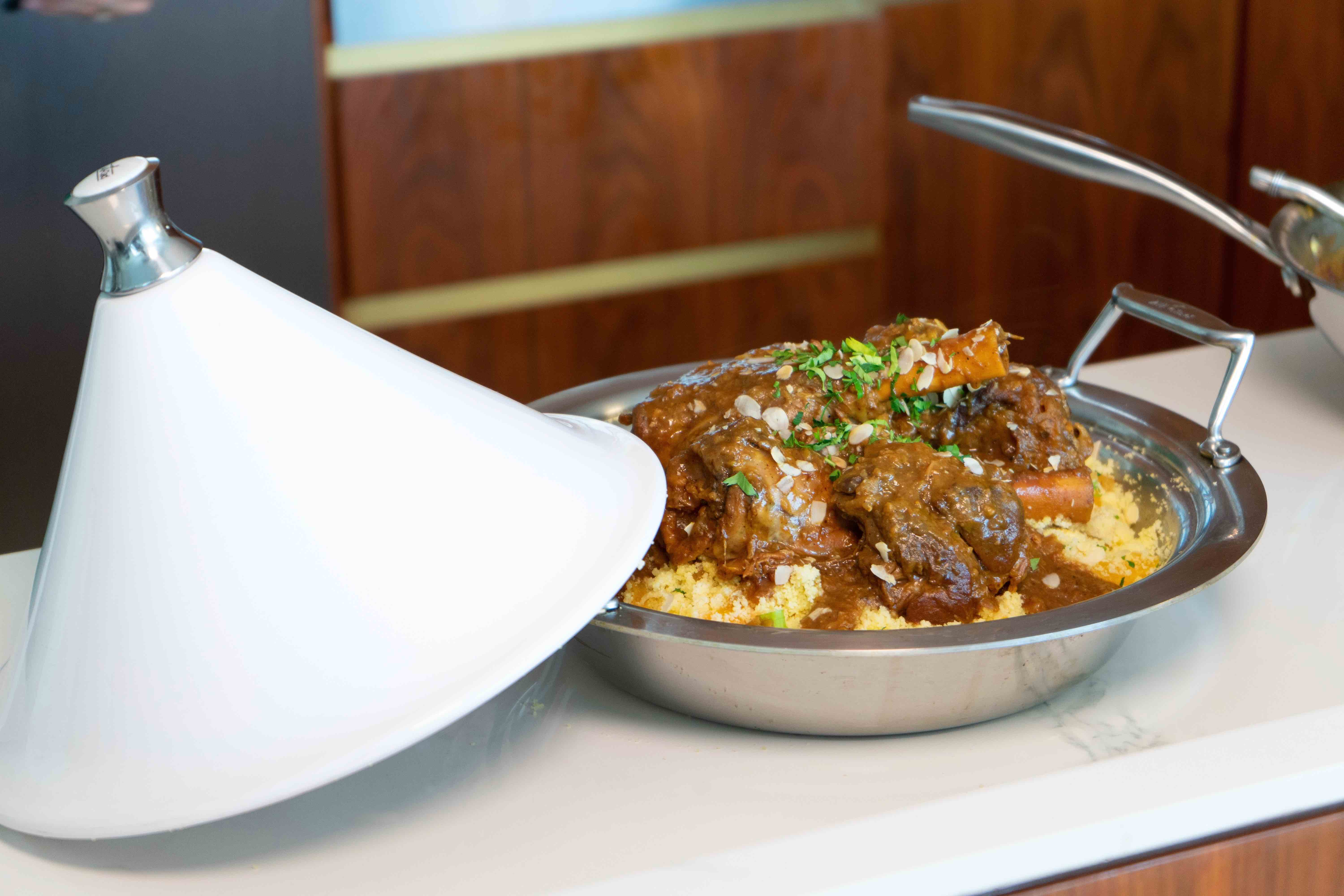 Spiced Lamb Shanks with Lentil Reduction and Almond Apricot Couscous